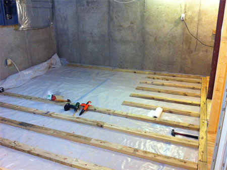 Basement questions basement flooring systems for Basement flooring over concrete